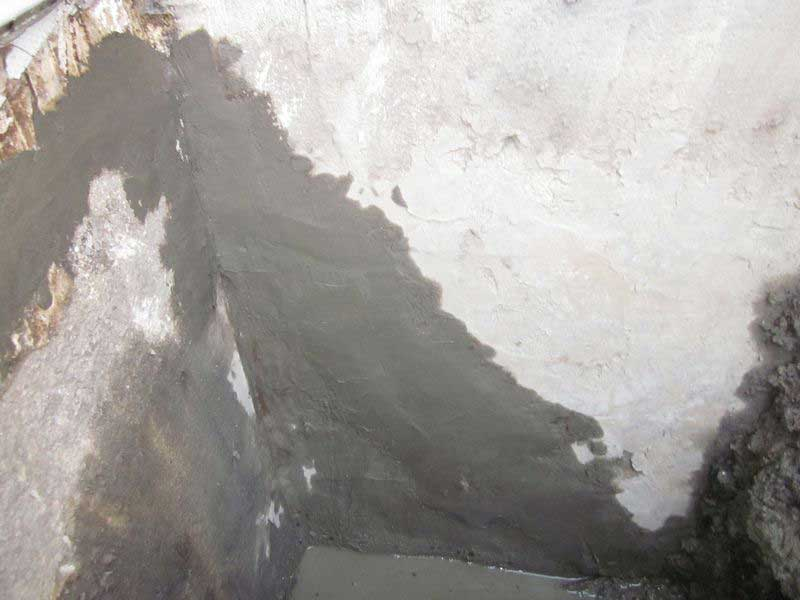 Alot of hydraulic cement (usually more than we prefer to use) applied to a large, deteriorated, cracked & crumbling wall