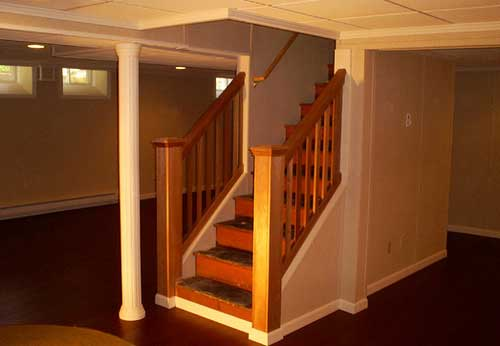 New staircase and banister leading into basement