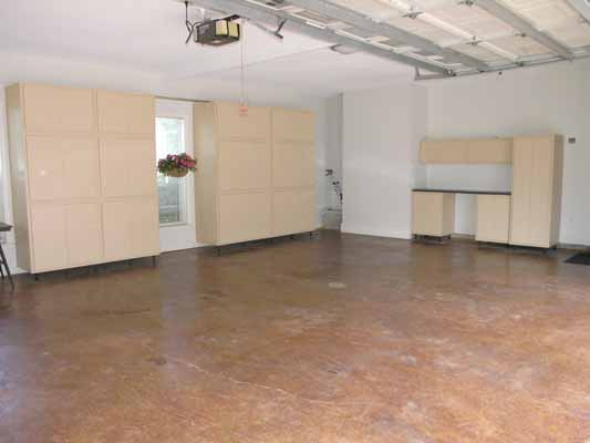 Redone garage with new floor and added shelving units
