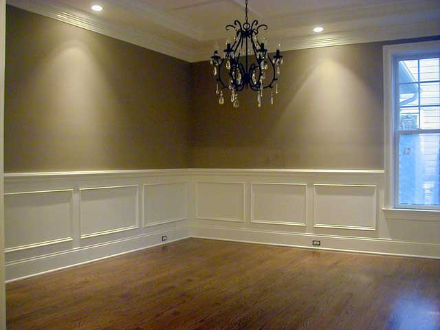 New floor, new paint job, and new wainscotting for this dining room