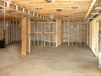 Picture showing water seepage through various areas of the basement walls and floor